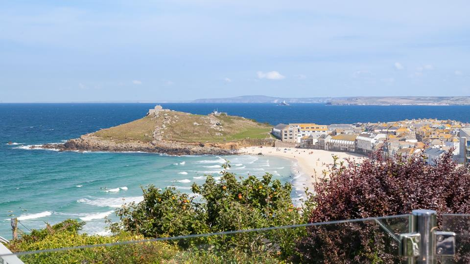 From the glass patio balcony, you have a birds-eye stunning view across Porthmeor beach and for miles beyond.