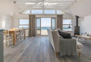 Outstanding open plan sitting/dining area with magnificent apex window that captures those ever changing views.