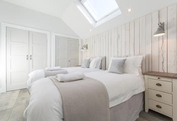 Spacious twin bedroom with en suite shower room.