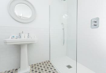 En suite with walk in shower.