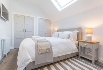 Cosy bright master bedroom.