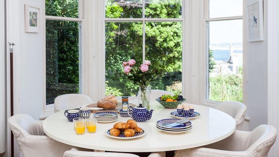The dining table nestles perfectly in the bay window overlooking Porthminster.