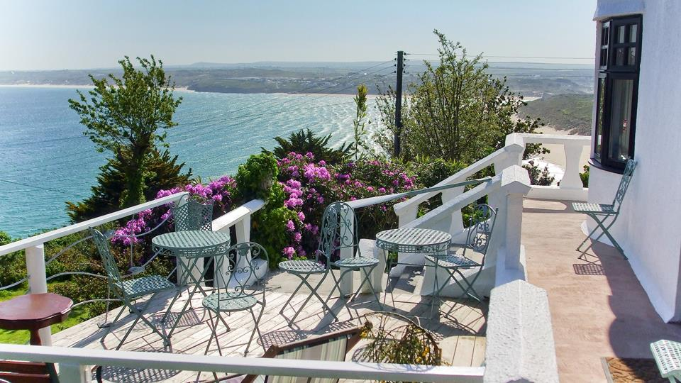 Relax on the terrace, overlooking the turquoise waters of Carbis Bay and beyond.