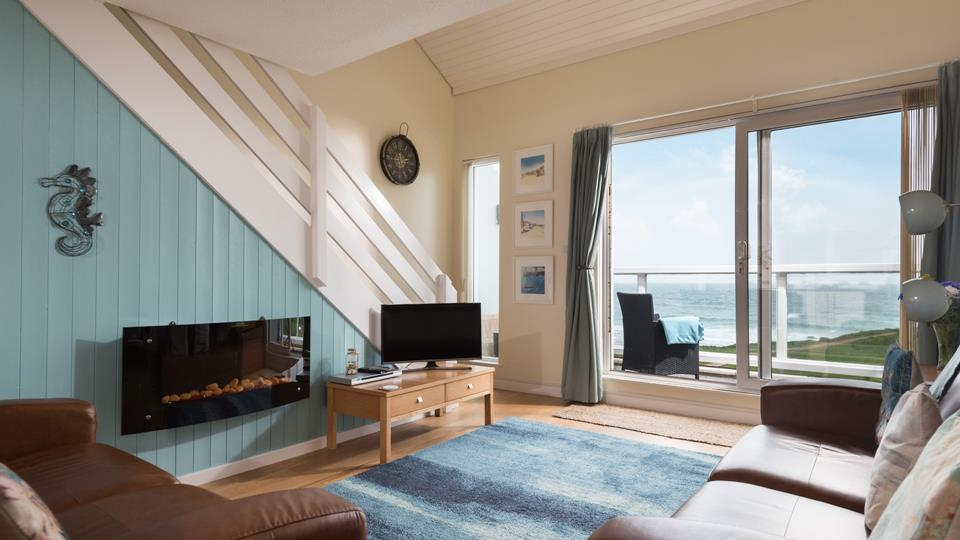 Double sliding patio doors lead out from the sitting room onto the balcony, with a stunning view over Porthmeor beach.