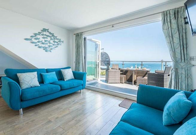 The sitting room is on the first floor and has incredible sea views.