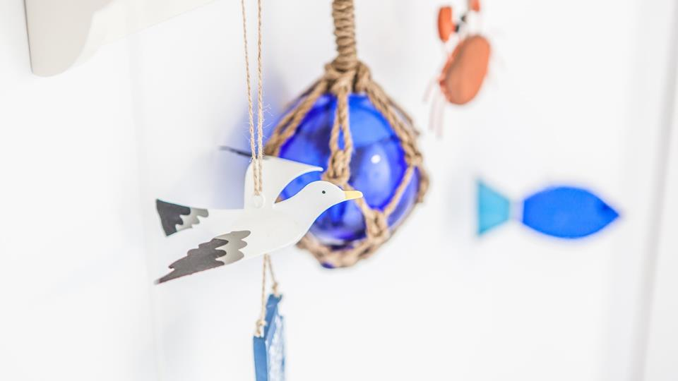 Sweet touches of nautical decor remind you just how close to the seaside you are.