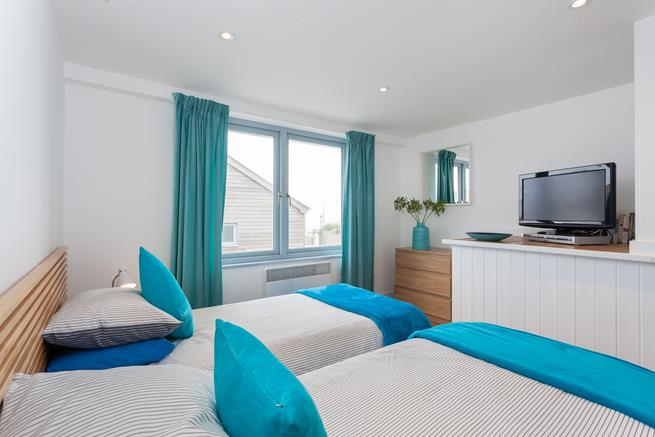 This bedroom is at the front of the property and has views over the beach.