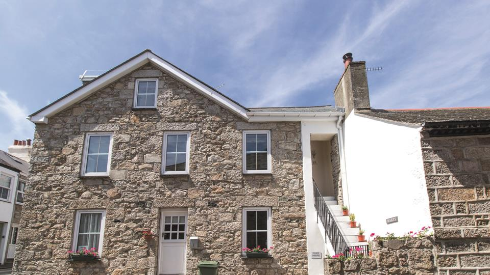 The property has a traditional Cornish granite facade with slate roof and sash style windows.