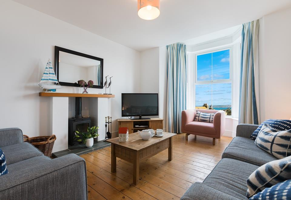 The sitting room is located on the ground floor, and enjoys sea views.