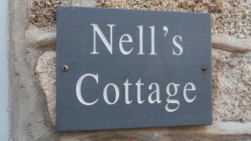 The traditional slate sign which blends well with the traditional granite stone facade.