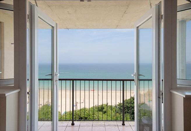 French doors from sitting/dining room to balcony with spectacular sea views.