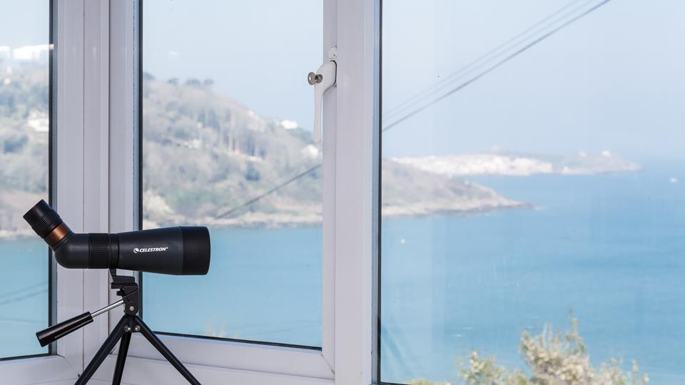 While away the hours admiring the view, use the telescope and you might be lucky enough to spot some dolphins!