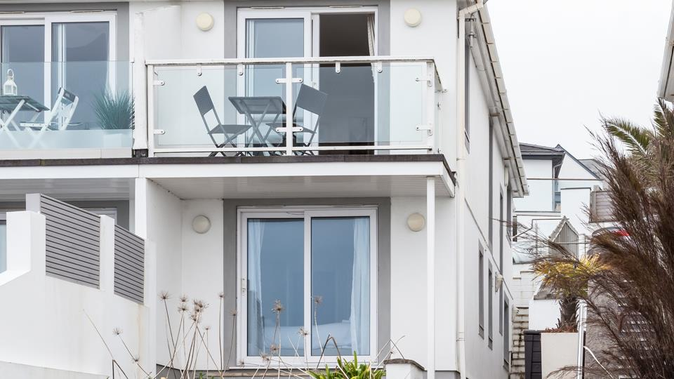 The private balcony has glass balustrading to take full advantage of the views across the bay.