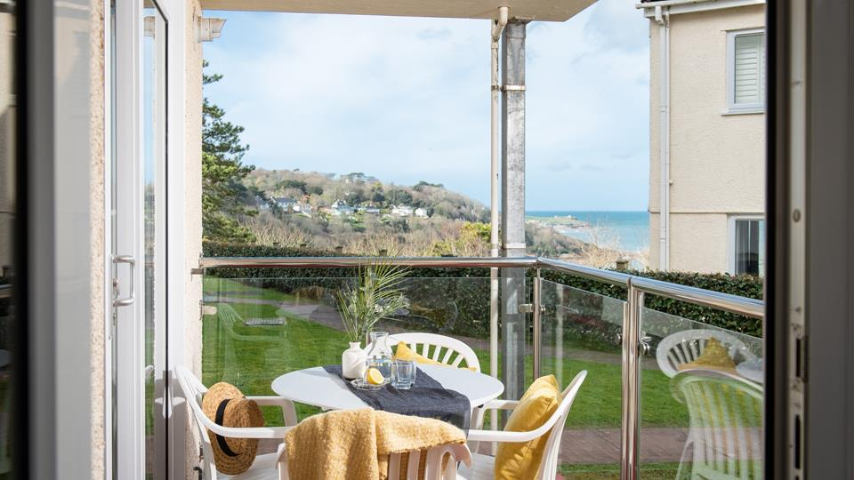 Relax on the private balcony whilst admiring the stunning coastal view.