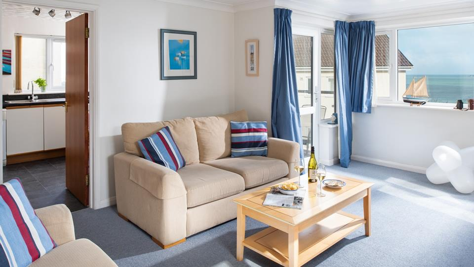 Light and airy, the living room encompasses a coastal theme, mirroring the sea views.