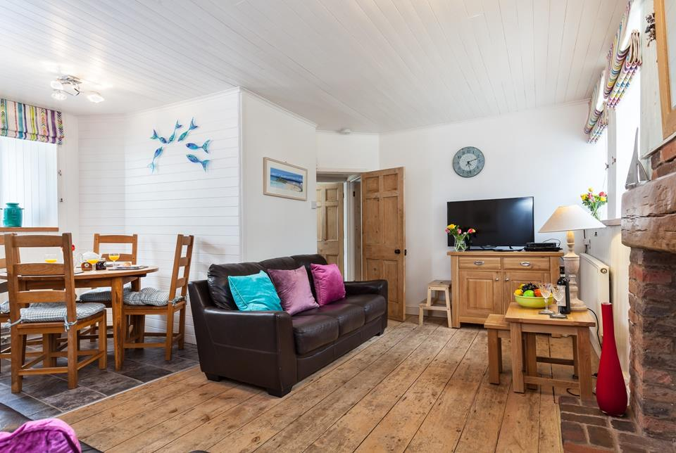 Cosy open plan living with original features.