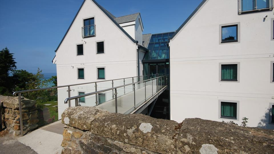 External shot of the Peninsula building which sits next to the St Ives Harbour Hotel and Spa.