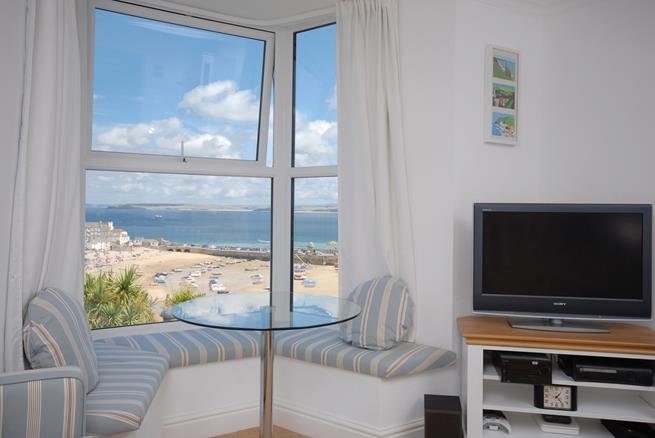 Enjoy the stunning views from the large bay window.