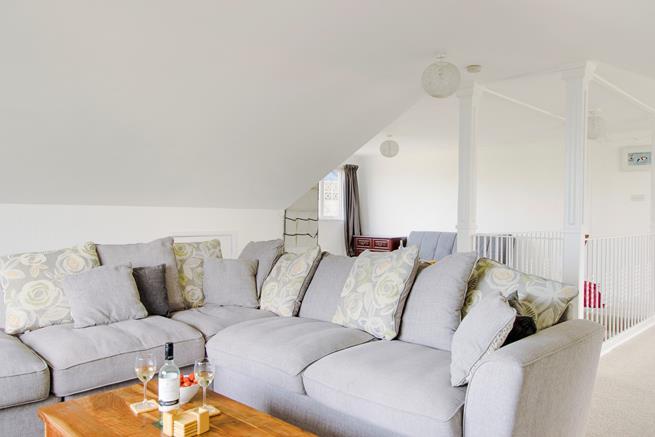 Large L-shaped sofa.