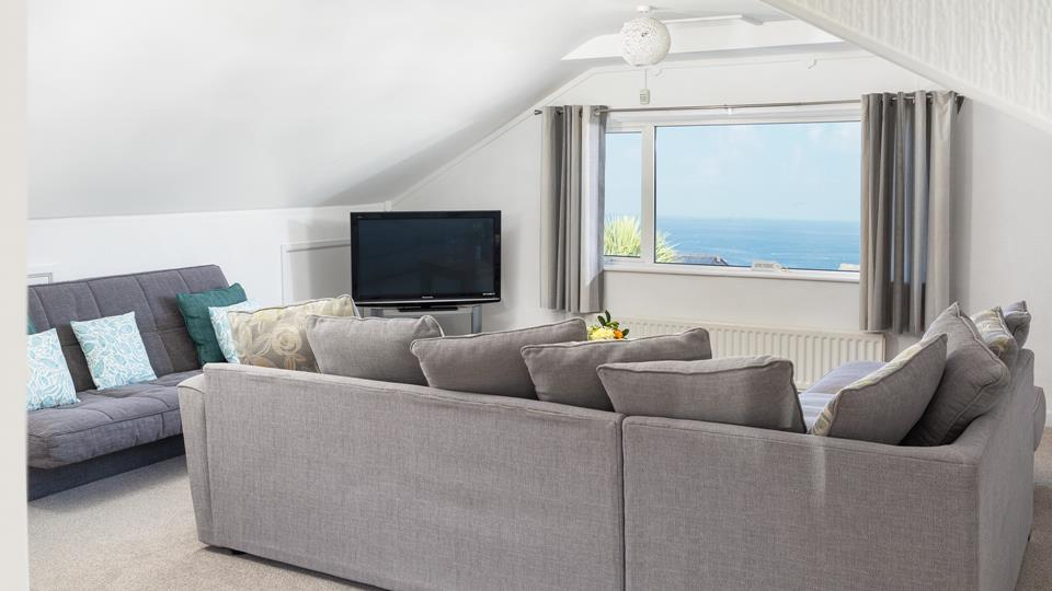 Open plan sitting room with sea views.