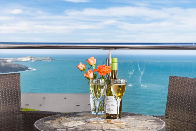 Relax on the balcony with your favourite tipple.