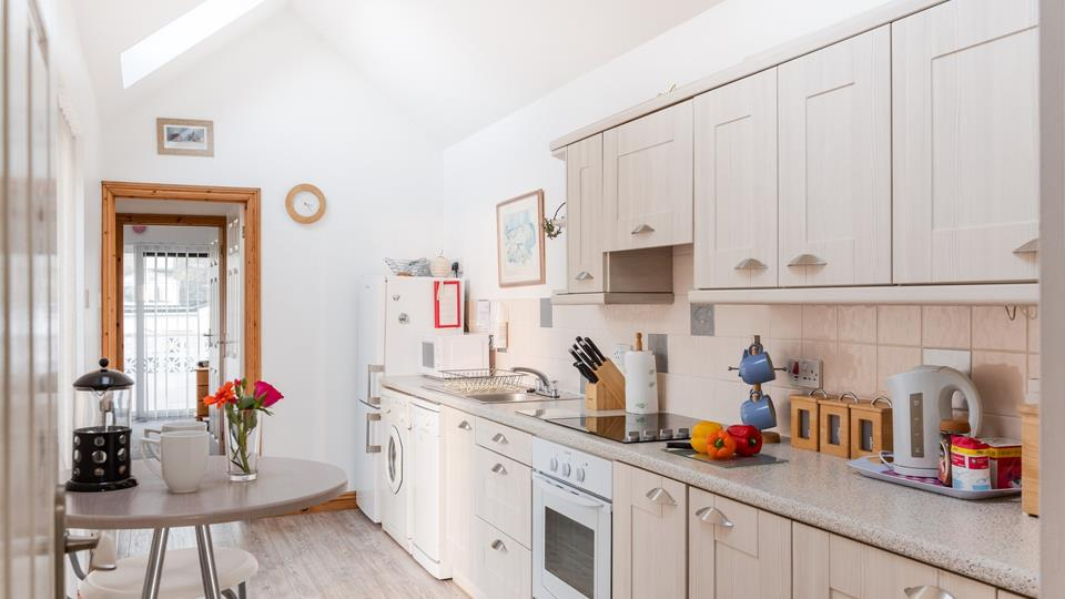 A light and airy country styled kitchen, ideal for cooking Cornish meals.