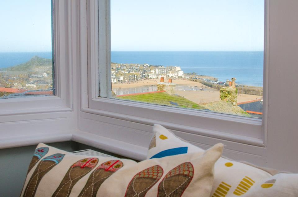 The view across St Ives Harbour from the sitting room is mesmerising.