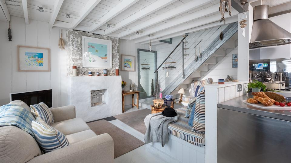 The cosy living area filled with nautical touches, is the perfect place to cosy up on an evening.