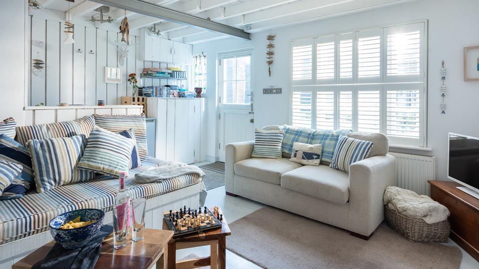 Enjoy serene coastal surroundings in the comfortable living room.