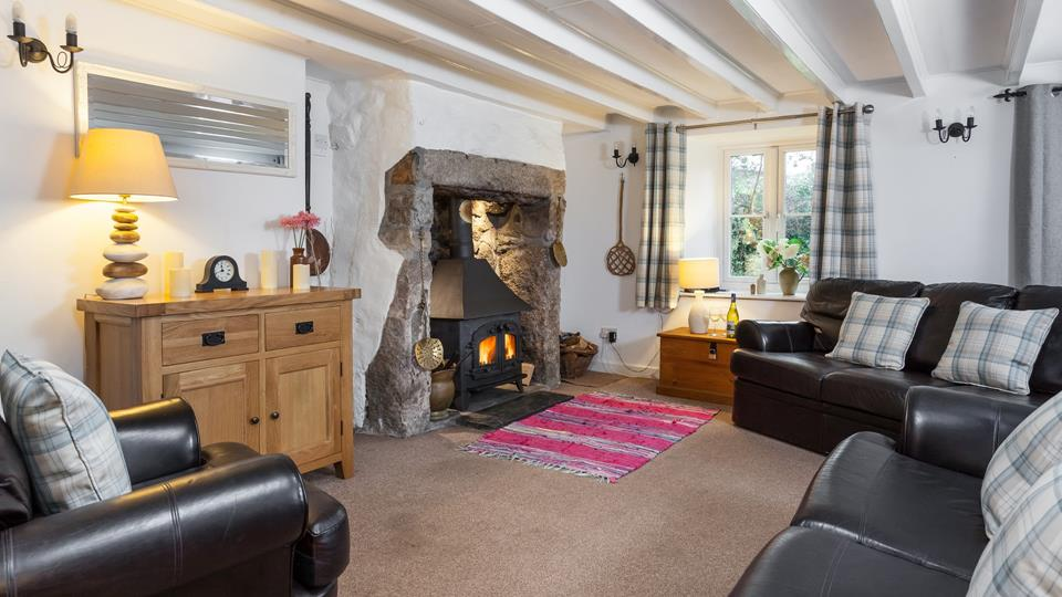 The sitting room area has an original granite inglenook fireplace with a slate hearth and wood burner.