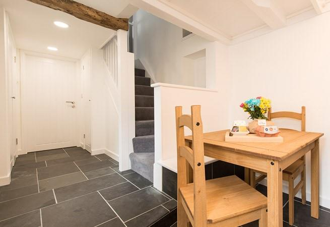 Door leading to the bathroom and stairs to the sitting room, bedrooms and outside area.