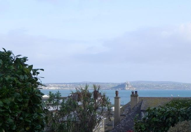 Look over the rooftops towards Marazion and the Lizard peninsular