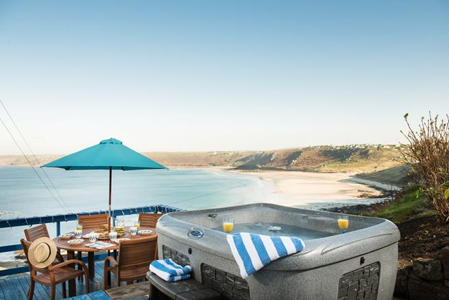Enjoy a drink in the hot tub overlooking the cove.