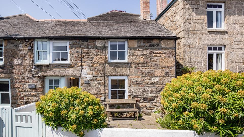 This traditional cottage is set back from a narrow low traffic road with a private outside area.