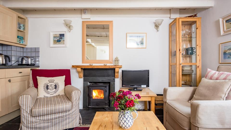 This cosy living area is a perfect way to unwind from a busy day exploring Mousehole - enjoy a glass of wine in front of the woodburner.