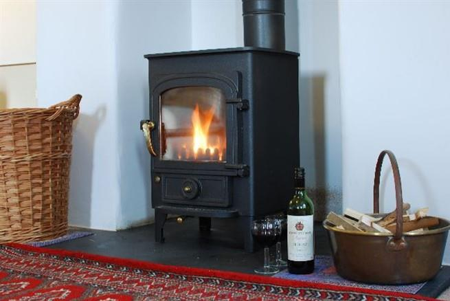 The wood burner will keep you warm and cosy in the cooler season