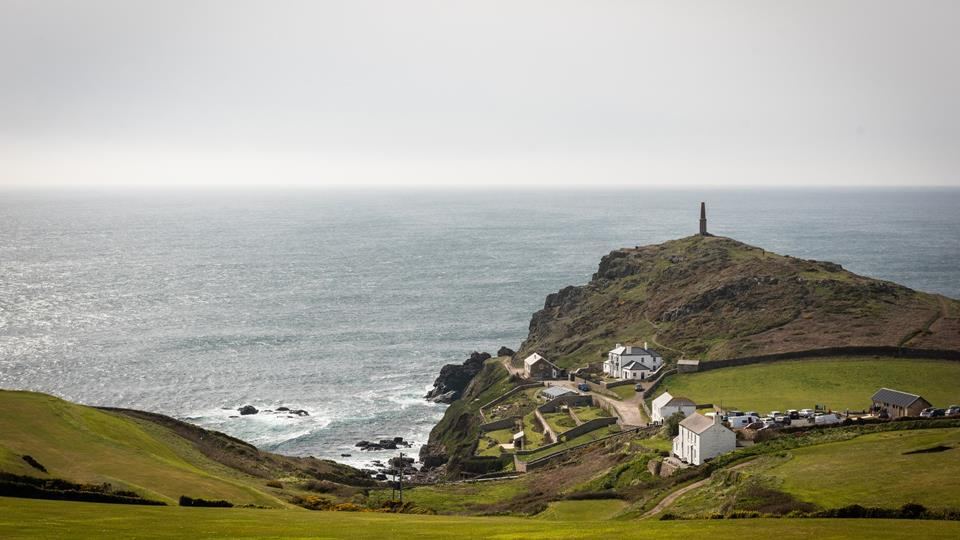 The distinctive headland juts out into the ocean where two great bodies of water meet.
