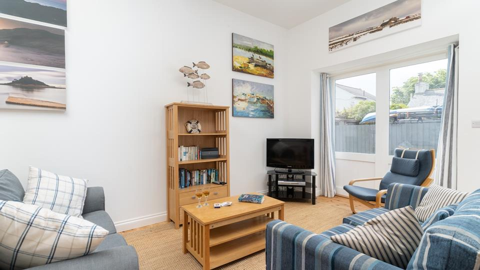A cosy space to put your feet up after a day of seaside adventures.