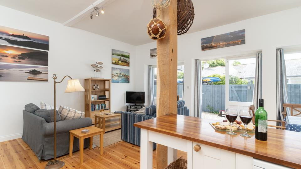 Enjoy a glass of wine with family and friends in the open plan living area.