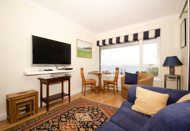 The living area is situated at the end of the open plan sitting/dining room and