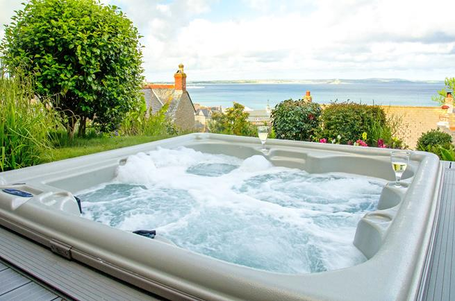 Soak up the sea view from the hot tub.