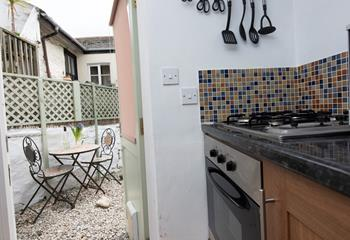 The kitchen door leads to the small courtyard patio.