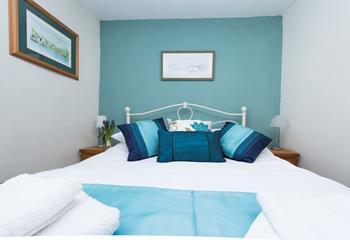 Calming tones of blue in the bedroom.