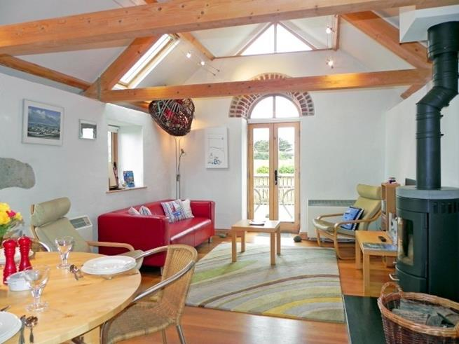 The light and airy open plan living space is at the top of the barn