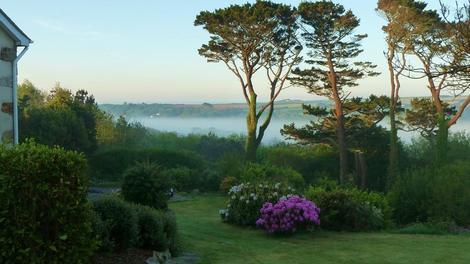 Morning mist settles in the valley at this story book setting.