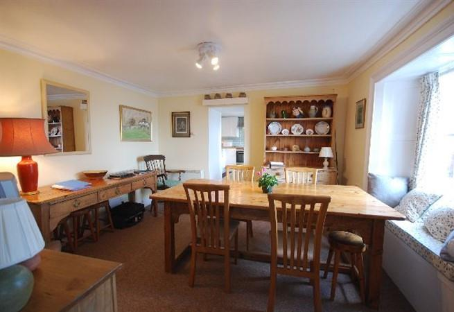 The combined kitchen/dining room is light and overlooks the garden and out to sea