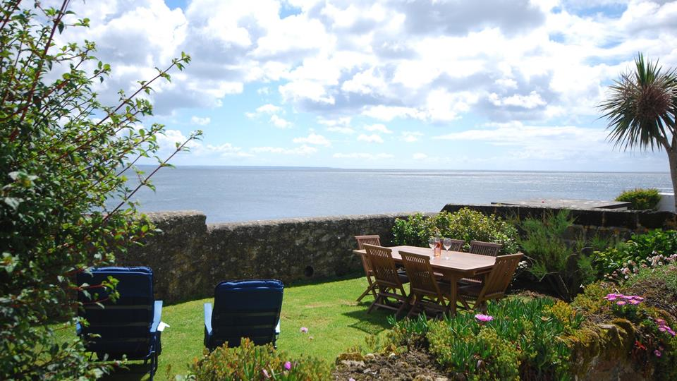The large garden to the front of the property has superb views and garden furniture for you to sit out and enjoy the surroundings.