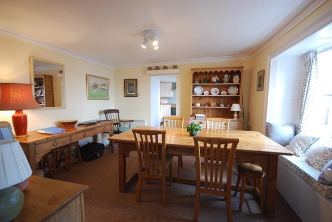 The combined kitchen/dining room is light and overlooks the garden and out to sea.