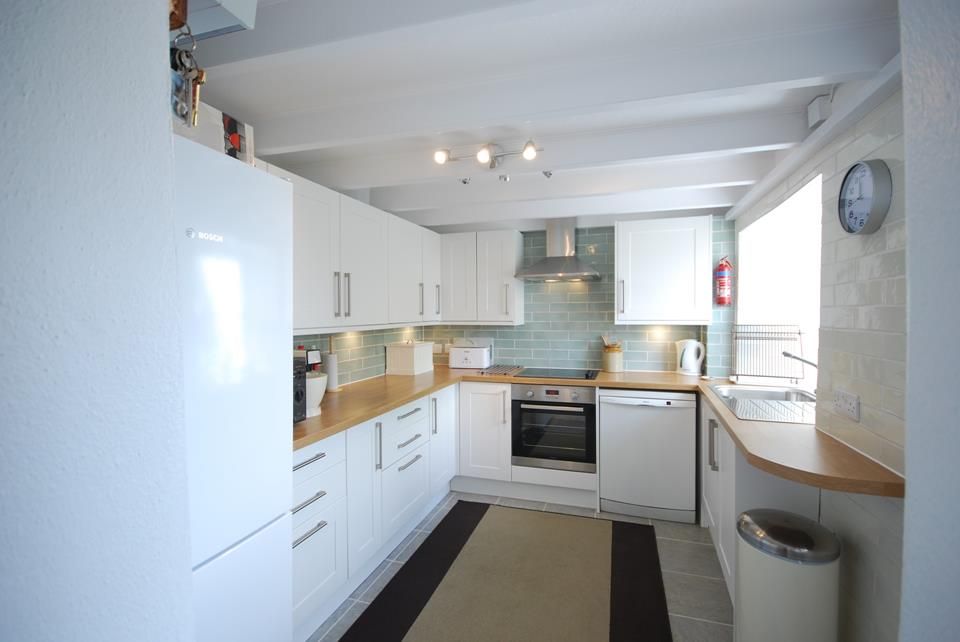 The kitchen area is well equipped for your self catering holiday and includes a dishwasher.