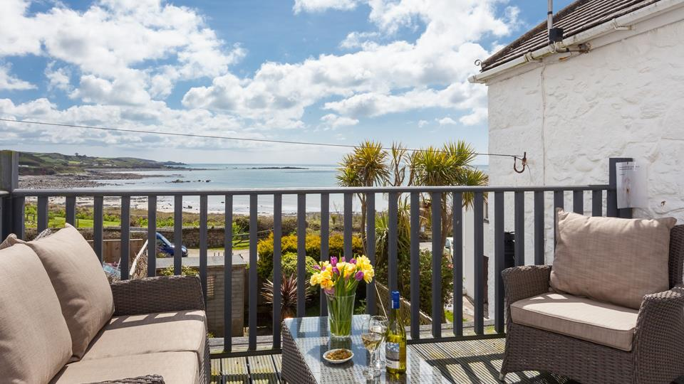 The first floor balcony leading from the landing looks out to beautiful views of Marazion beach - perfect to enjoy a glass of wine.